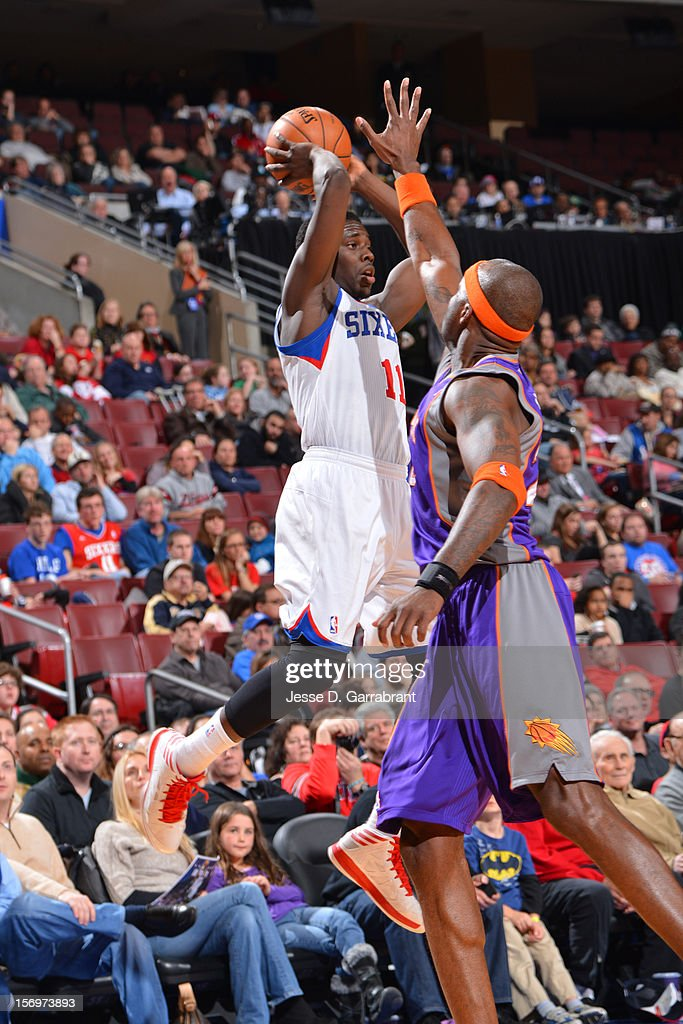 Jrue Holiday #11 of the Philadelphia 76ers makes a pass against the Phoenix Suns at the Wells Fargo Center on November 25, 2012 in Philadelphia, Pennsylvania.