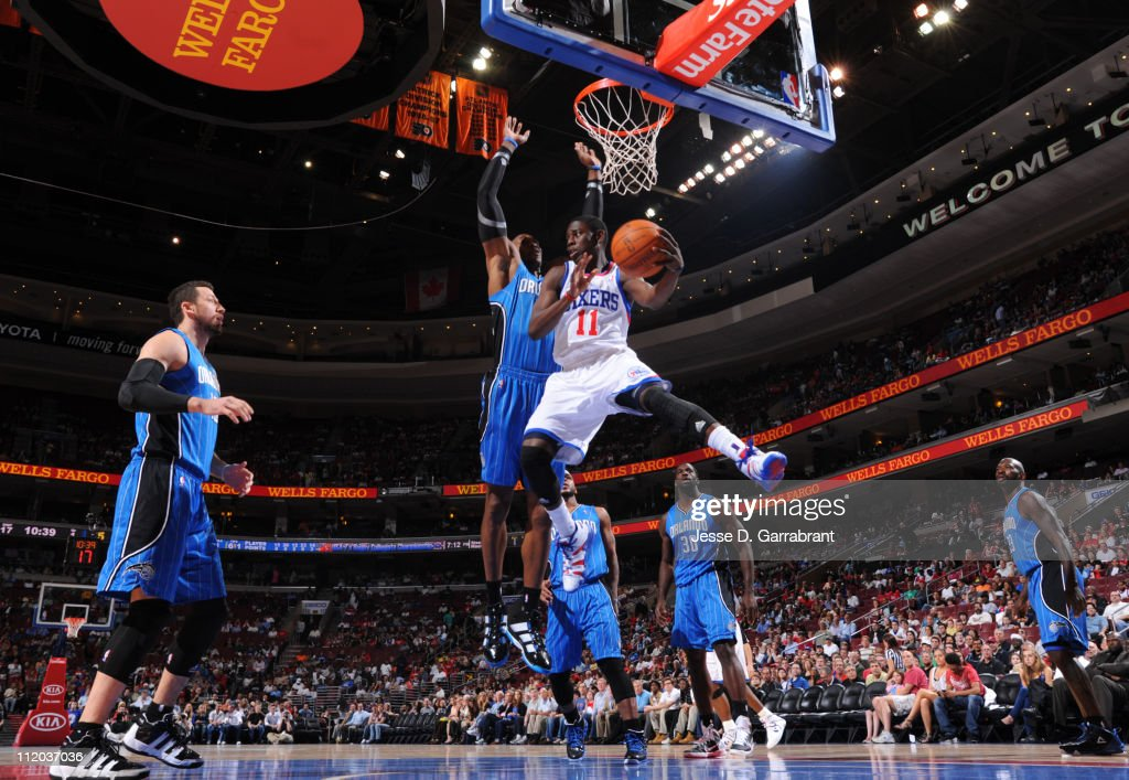 <a gi-track='captionPersonalityLinkClicked' href=/galleries/search?phrase=Jrue+Holiday&family=editorial&specificpeople=5042484 ng-click='$event.stopPropagation()'>Jrue Holiday</a> #11 of the Philadelphia 76ers passes against <a gi-track='captionPersonalityLinkClicked' href=/galleries/search?phrase=Dwight+Howard&family=editorial&specificpeople=201570 ng-click='$event.stopPropagation()'>Dwight Howard</a> #12 of the Orlando Magic on April 11, 2011 at the Wells Fargo Center in Philadelphia, Pennsylvania.