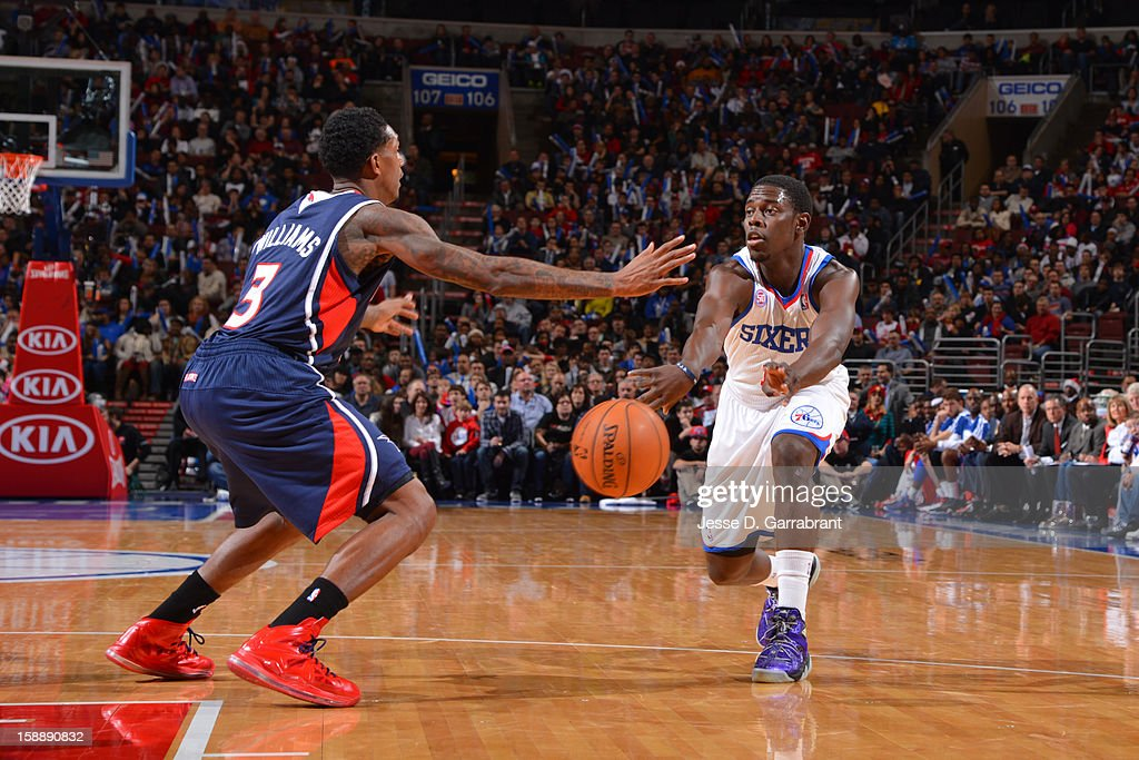 <a gi-track='captionPersonalityLinkClicked' href=/galleries/search?phrase=Jrue+Holiday&family=editorial&specificpeople=5042484 ng-click='$event.stopPropagation()'>Jrue Holiday</a> #11 of the Philadelphia 76ers passes the ball against <a gi-track='captionPersonalityLinkClicked' href=/galleries/search?phrase=Louis+Williams&family=editorial&specificpeople=670315 ng-click='$event.stopPropagation()'>Louis Williams</a> #3 of the Atlanta Hawks during the game at the Wells Fargo Center on December 21, 2012 in Philadelphia, Pennsylvania.