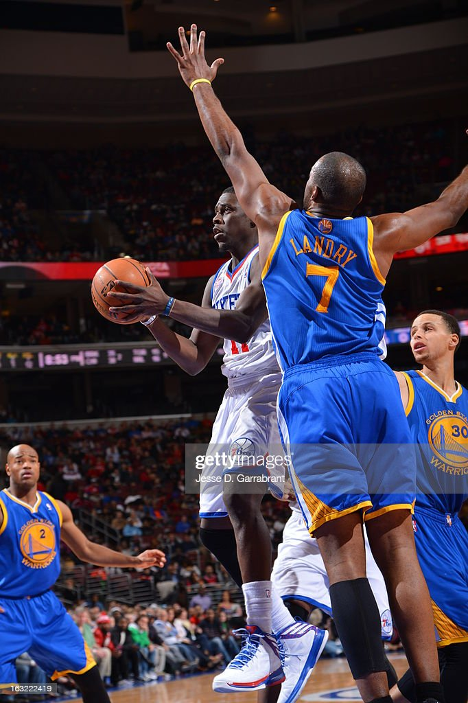 <a gi-track='captionPersonalityLinkClicked' href=/galleries/search?phrase=Jrue+Holiday&family=editorial&specificpeople=5042484 ng-click='$event.stopPropagation()'>Jrue Holiday</a> #11 of the Philadelphia 76ers passes the ball against the Golden State Warriors on March 2, 2013 at the Wells Fargo Center in Philadelphia, Pennsylvania.
