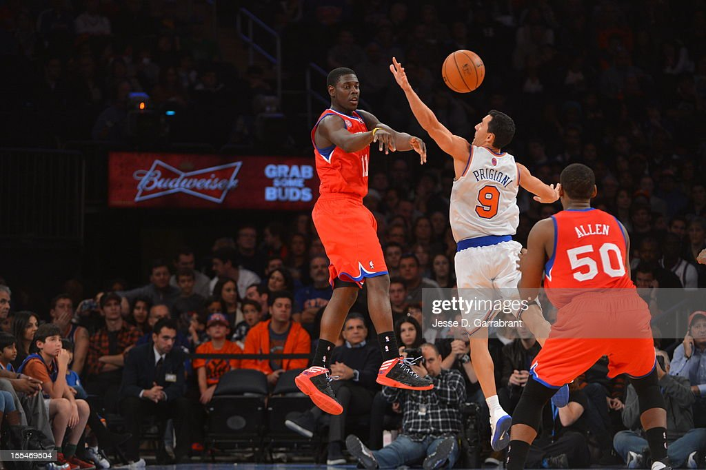 Jrue Holiday #11 of the Philadelphia 76ers passes the ball to Lavoy Allen #50 , while Pablo Prigioni #9 of the New York Knicks defends the pass on November 4, 2012 at Madison Square Garden in New York City.