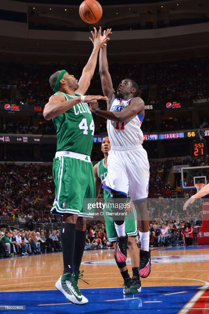 Jrue Holiday #11 of the Philadelphia 76ers puts up a shot over Chris Wilcox #44 of the Boston Celtics on March 5, 2013 at the Wells Fargo Center in Philadelphia, Pennsylvania.