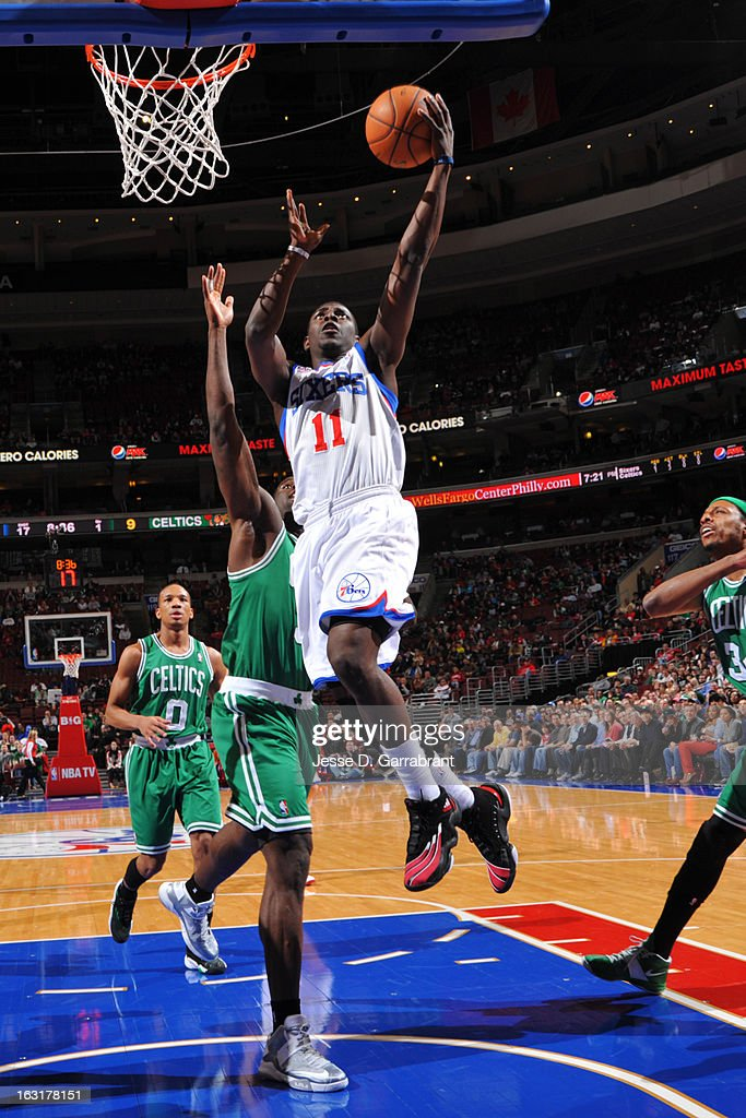 Jrue Holiday #11 of the Philadelphia 76ers shoots a driving layup against the Boston Celtics on March 5, 2013 at the Wells Fargo Center in Philadelphia, Pennsylvania.