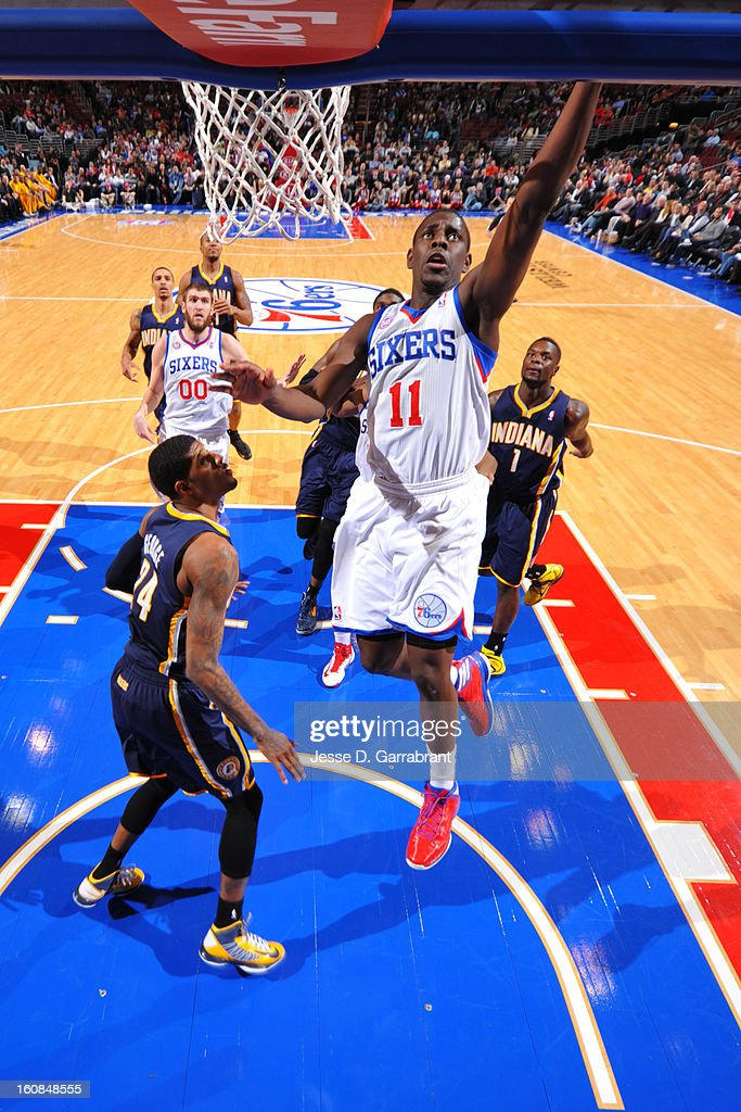 Jrue Holiday #11 of the Philadelphia 76ers shoots a layup against Paul George #24 of the Indiana Pacers during the game at the Wells Fargo Center on February 6, 2013 in Philadelphia, Pennsylvania.