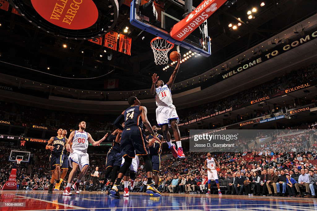 <a gi-track='captionPersonalityLinkClicked' href=/galleries/search?phrase=Jrue+Holiday&family=editorial&specificpeople=5042484 ng-click='$event.stopPropagation()'>Jrue Holiday</a> #11 of the Philadelphia 76ers shoots a layup against <a gi-track='captionPersonalityLinkClicked' href=/galleries/search?phrase=Paul+George+-+Basketballspieler&family=editorial&specificpeople=7235030 ng-click='$event.stopPropagation()'>Paul George</a> #24 of the Indiana Pacers during the game at the Wells Fargo Center on February 6, 2013 in Philadelphia, Pennsylvania.