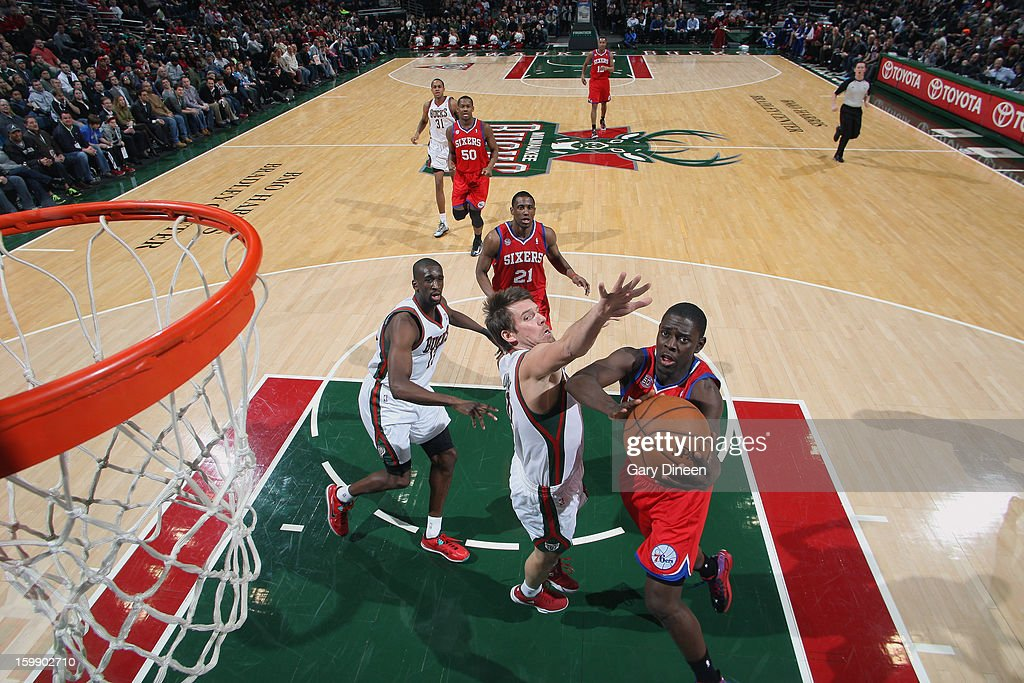 <a gi-track='captionPersonalityLinkClicked' href=/galleries/search?phrase=Jrue+Holiday&family=editorial&specificpeople=5042484 ng-click='$event.stopPropagation()'>Jrue Holiday</a> #11 of the Philadelphia 76ers shoots against <a gi-track='captionPersonalityLinkClicked' href=/galleries/search?phrase=Beno+Udrih&family=editorial&specificpeople=202616 ng-click='$event.stopPropagation()'>Beno Udrih</a> #19 of the Milwaukee Bucks on January 22, 2013 at the BMO Harris Bradley Center in Milwaukee, Wisconsin.