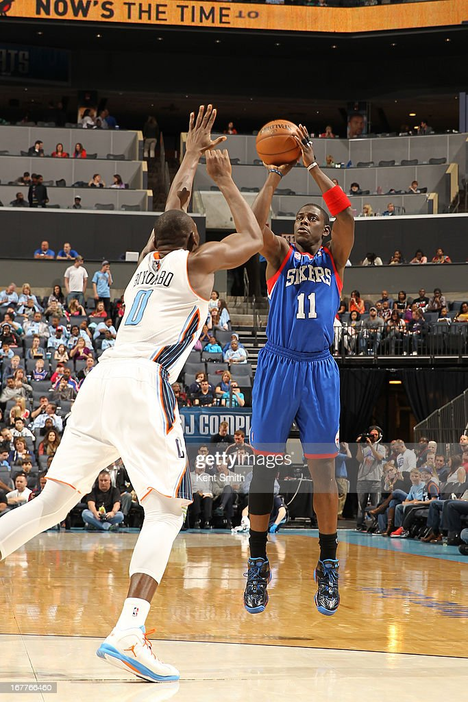 Jrue Holiday #11 of the Philadelphia 76ers shoots against Bismack Biyombo #0 of the Charlotte Bobcats at the Time Warner Cable Arena on April 3, 2013 in Charlotte, North Carolina.