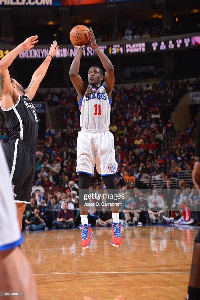 <a gi-track='captionPersonalityLinkClicked' href=/galleries/search?phrase=Jrue+Holiday&family=editorial&specificpeople=5042484 ng-click='$event.stopPropagation()'>Jrue Holiday</a> #11 of the Philadelphia 76ers shoots against <a gi-track='captionPersonalityLinkClicked' href=/galleries/search?phrase=Deron+Williams&family=editorial&specificpeople=203215 ng-click='$event.stopPropagation()'>Deron Williams</a> #8 of the Brooklyn Nets during the game at the Wells Fargo Center on January 8, 2013 in Philadelphia, Pennsylvania.