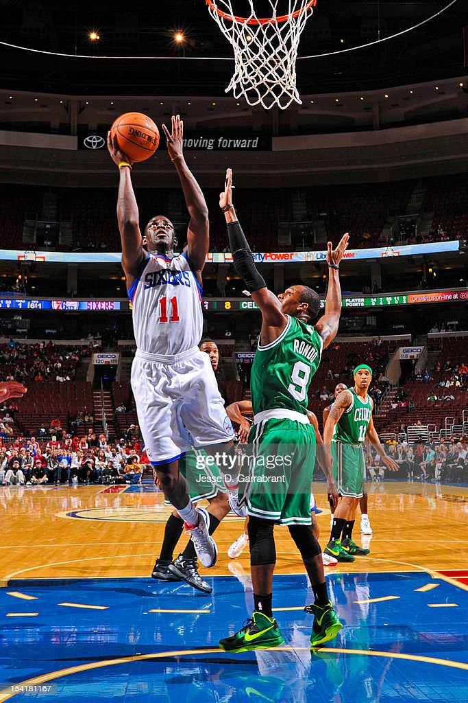 Jrue Holiday #11 of the Philadelphia 76ers shoots against Rajon Rondo #9 of the Boston Celtics during a pre-season game at the Wells Fargo Center on October 15, 2012 in Philadelphia, Pennsylvania.