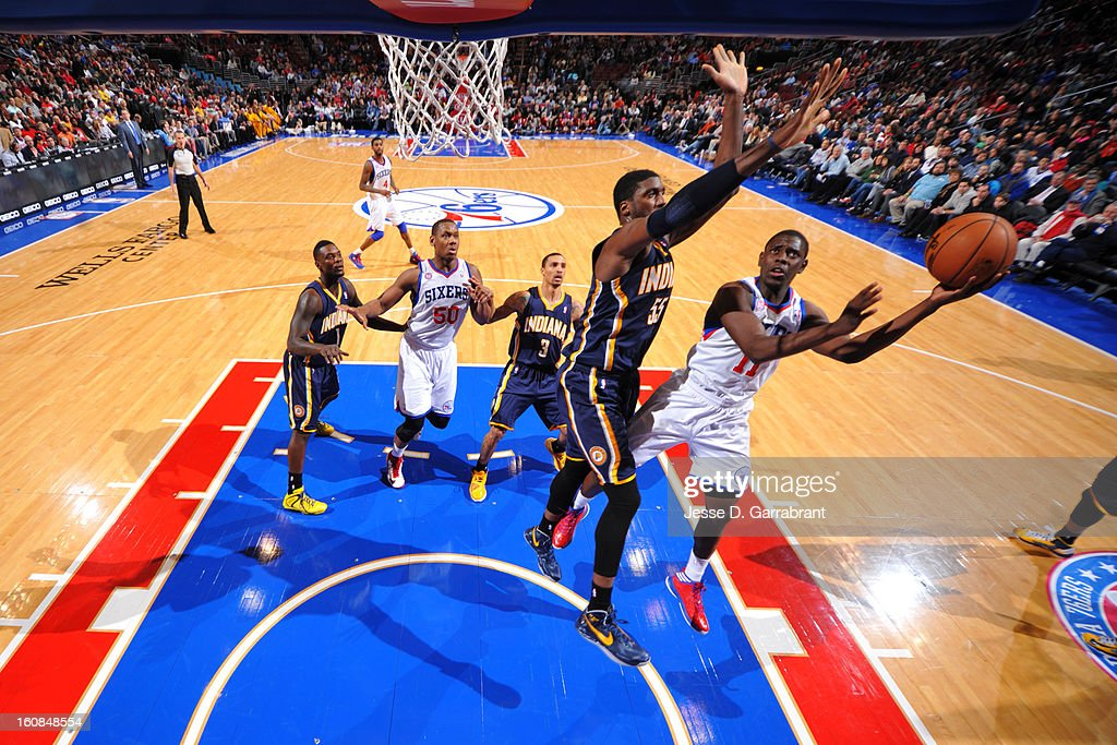 Jrue Holiday #11 of the Philadelphia 76ers shoots against Roy Hibbert #55 of the Indiana Pacers during the game at the Wells Fargo Center on February 6, 2013 in Philadelphia, Pennsylvania.