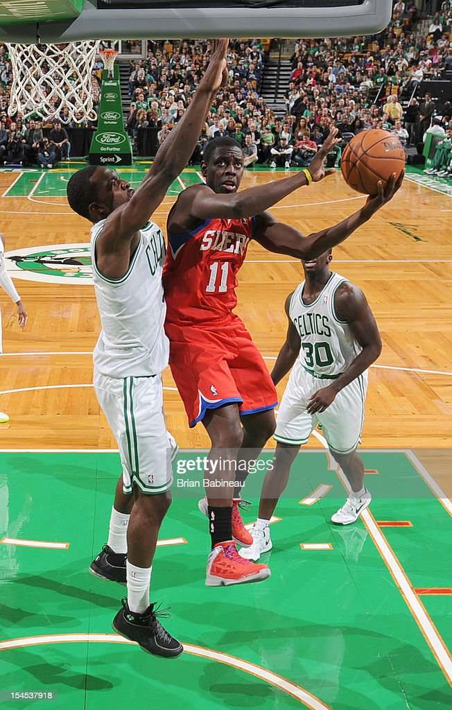 Jrue Holiday #11 of the Philadelphia 76ers shoots the ball against Jeff Green #8 of the Boston Celtics on October 21, 2012 at the TD Garden in Boston, Massachusetts.