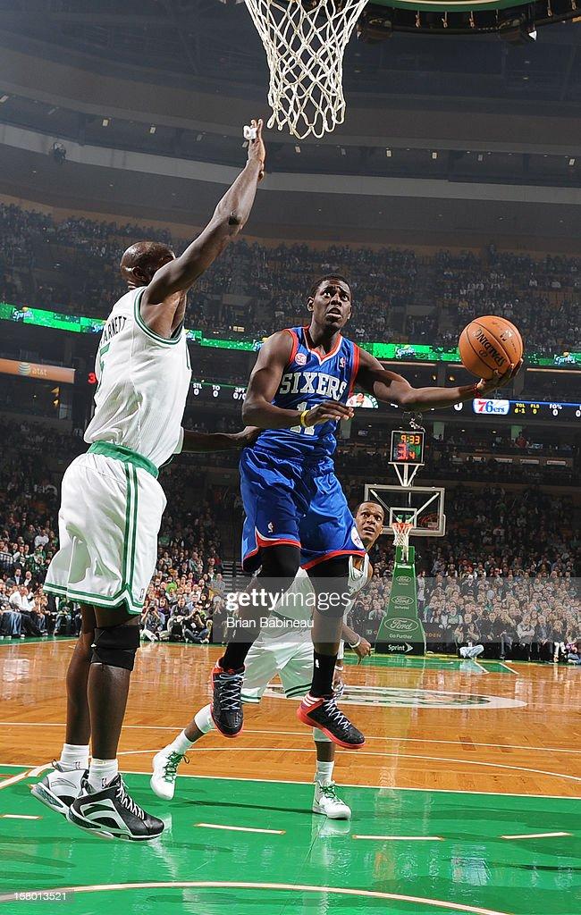Jrue Holiday #11 of the Philadelphia 76ers shoots the ball against Kevin Garnett #5 of the Boston Celtics on December 8, 2012 at the TD Garden in Boston, Massachusetts.
