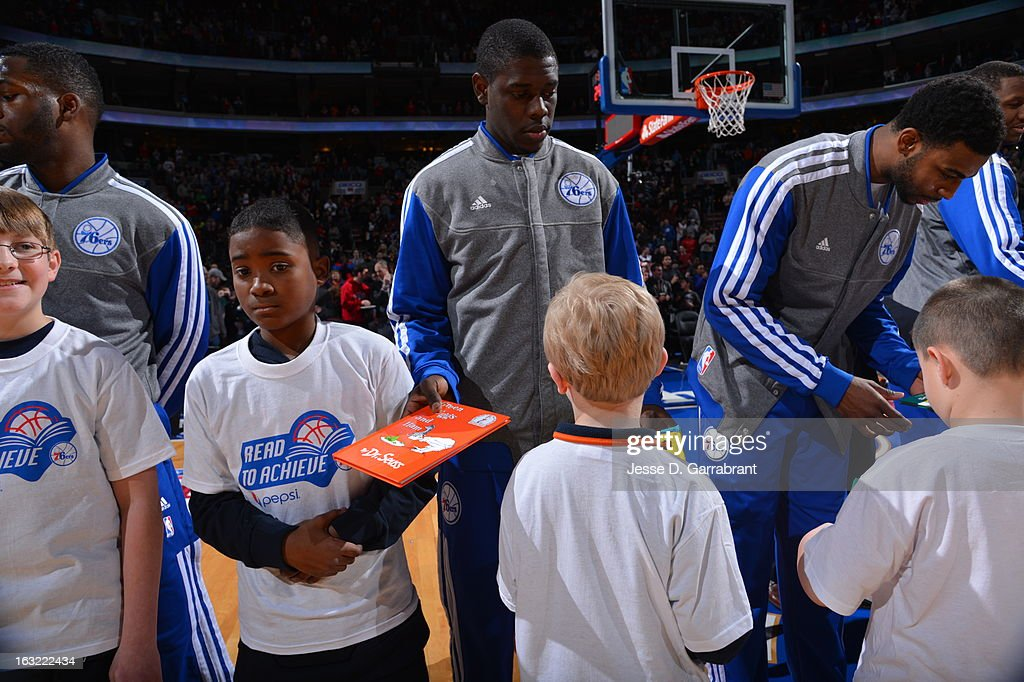 <a gi-track='captionPersonalityLinkClicked' href=/galleries/search?phrase=Jrue+Holiday&family=editorial&specificpeople=5042484 ng-click='$event.stopPropagation()'>Jrue Holiday</a> #11 of the Philadelphia 76ers stands on the court before the game against the Golden State Warriors on March 2, 2013 at the Wells Fargo Center in Philadelphia, Pennsylvania.