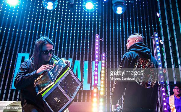 Splif and Kev Nish of Far East Movement perform during Universal CityWalk's 'Music Spotlight Series' at 5 Towers Outdoor Concert Arena on August 28...