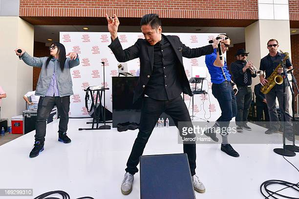 JSplif Kev Nish and Prohgress of Far East Movement perform at Macy's American Airlines Celebrate AsianPacific American Heritage Month with Far East...