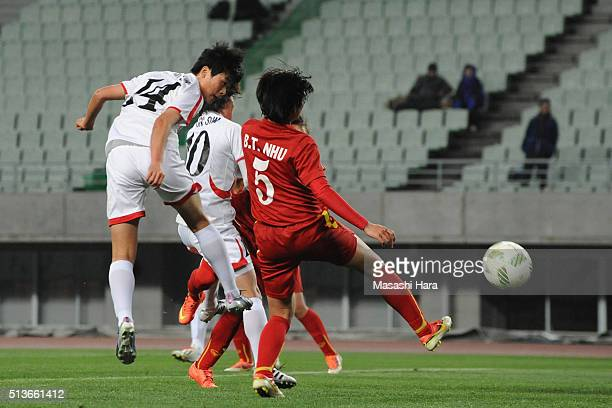 Ju Hyo Sim of North Korea heads the ball to score her team's first goal during the AFC Women's Olympic Final Qualification Round match between...