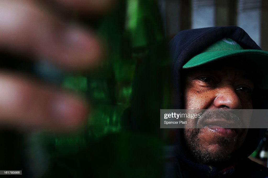 'Juan', a man who makes a living by collecting bottles and cans or 'canning' for short, pauses at Sure We Can, a non-profit bottle redemption center in Bushwick, Brooklyn that is pushing to become a cooperative for the canning community on February 16, 2013 in New York City. Sure We Can, which was partly started by homeless canners in 2007 and is run by one of its founders Sister Ana Martinez de Luco, looks to give the diverse members of the canning community a safe and fraternal place to redeem cans, store their carriages and become members of an association that encourages self-dependence and responsibility. Many of New York's canners are non-English-speaking elderly immigrants who live a marginalized existence and are vulnerable to dishonest business practices. Sure We Can currently serves around 50 canners per day and recycles over 6 million bottles and cans per year.