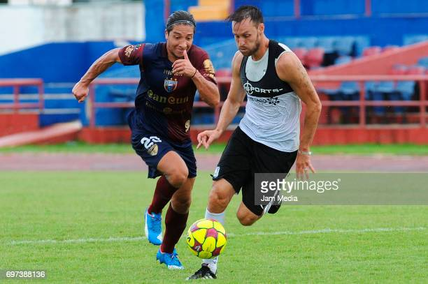 Juan Abarca of Atlante and Gerardo Lugo of Queretaro vie for the ball during the Pre Season training match for the Torneo Apertura 2017 Liga MX...