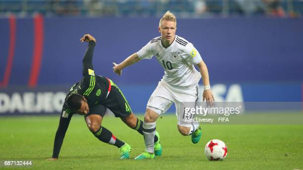 Juan Aguayo of Mexico is beaten by Philipp Ochs of Germany during the FIFA U20 World Cup Korea Republic 2017 group B match between Mexico and Germany...
