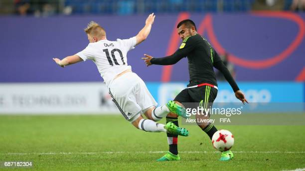 Juan Aguayo of Mexico tackles Philipp Ochs of Germany during the FIFA U20 World Cup Korea Republic 2017 group B match between Mexico and Germany at...