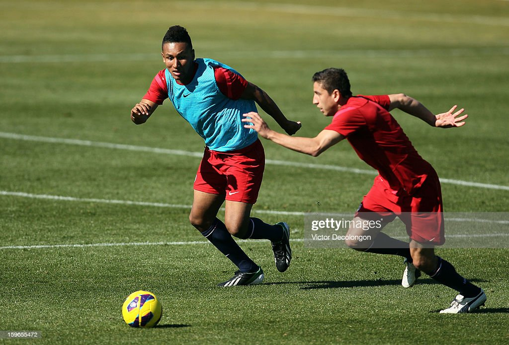 Juan Agudelo (light blue jersey) and Alejandro Bedoya vie for the ball during the U.S. Men's Soccer Team training session at the Home Depot Center on January 17, 2013 in Carson, California.