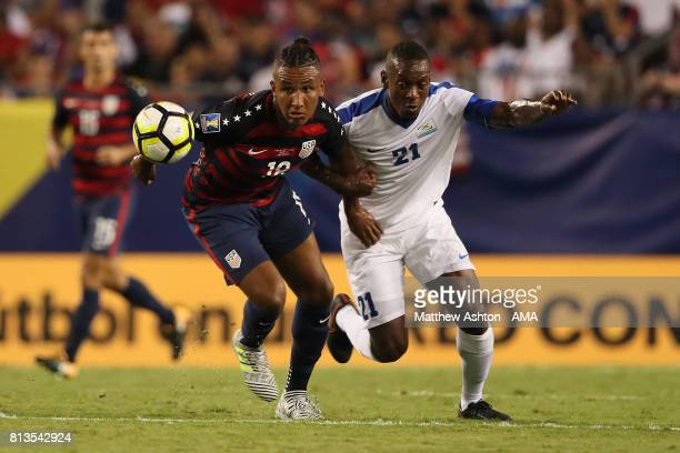 Juan Agudelo of the United States competes with Sebastian Cretinoir of Martinique during the 2017 CONCACAF Gold Cup Group B match between the United...