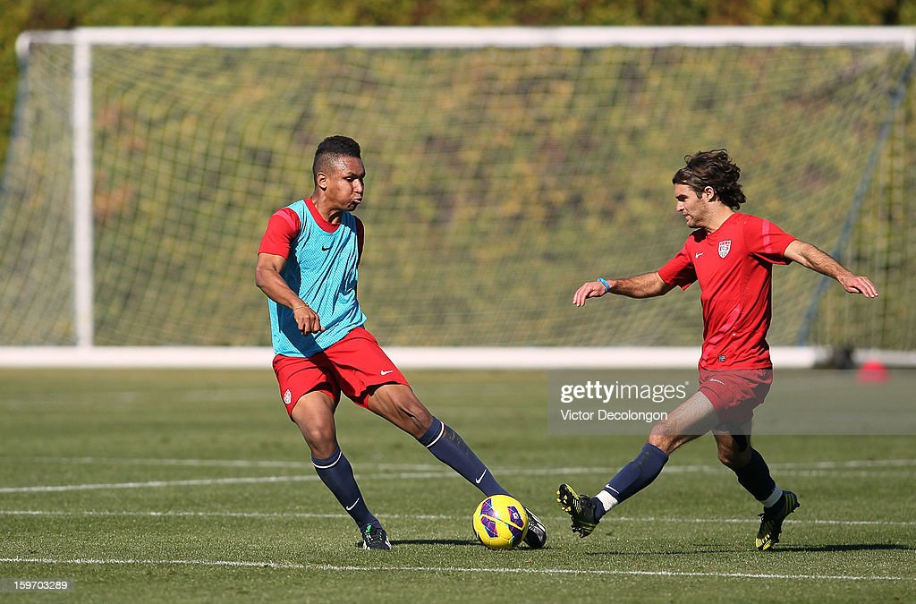 Juan Agudelo puts a shot on goal as Graham Zusi tries to defend the play during the U.S. Men's Soccer Team training session at the Home Depot Center on January 17, 2013 in Carson, California.