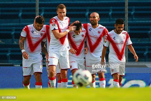 Juan Albin of Veracruz celebrates with teammates after scoring the second goal of his team during the 12th round match between Cruz Azul and Veracruz...