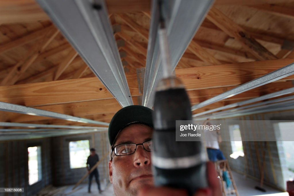 Juan Alvarez uses a drill as he helps build a Habitat for Humanity home on August 3, 2010 in Fort Lauderdale, Florida. In July, Habitat for Humanity was named the eighth largest homebuilder in the United States by Builder's Magazine, the first time the nonprofit has been among the top 10 biggest builders in the United States.