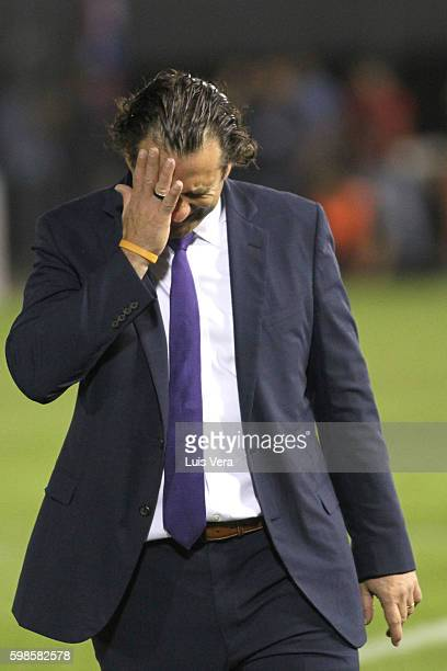 Juan Antonio Pizzi coach of Chile looks dejected during a match between Paraguay and Chile as part of FIFA 2018 World Cup Qualifiers at Defensores...