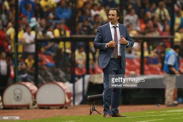 Juan Antonio Pizzi coach of Leon gestures during the quarterfinals first leg match between America and Leon as part of the Apertura 2015 Liga MX at...