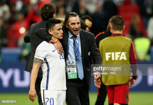 Juan Antonio Pizzi of Chile celebrates with Charles Aranguiz of Chile after the FIFA Confederations Cup Russia 2017 SemiFinal between Portugal and...