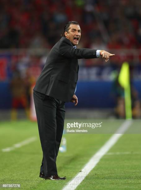 Juan Antonio Pizzi of Chile gives his team instructions during the FIFA Confederations Cup Russia 2017 Group B match between Cameroon and Chile at...