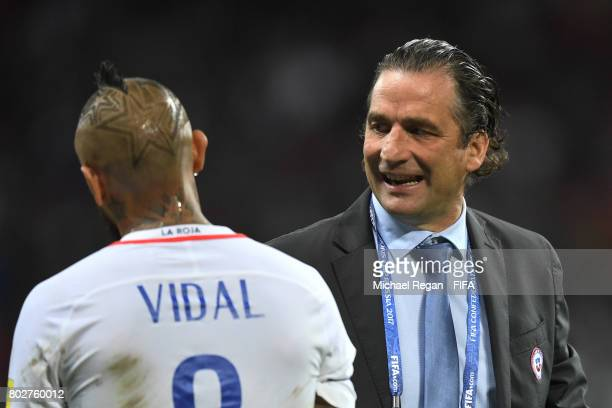 Juan Antonio Pizzi of Chile speaks to Arturo Vidal of Chile during the FIFA Confederations Cup Russia 2017 SemiFinal between Portugal and Chile at...