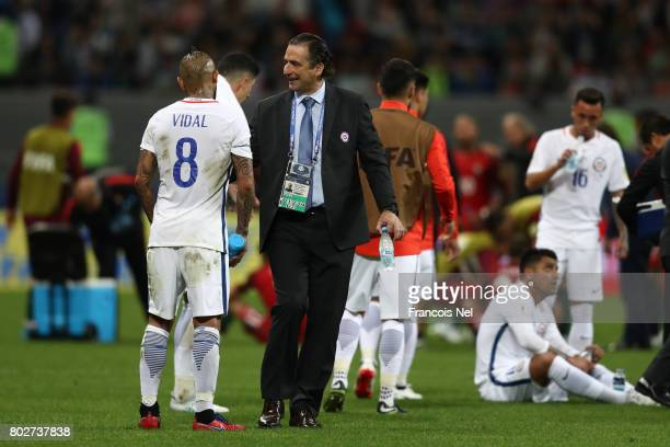 Juan Antonio Pizzi of Chile speaks to Arturo Vidal of Chile prior to extra time during the FIFA Confederations Cup Russia 2017 SemiFinal between...