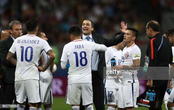 Juan Antonio Pizzi of Chile speaks to his players prior to extra time during the FIFA Confederations Cup Russia 2017 SemiFinal between Portugal and...