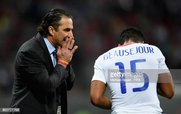 Juan Antonio Pizzi of Chile speaks to Jean Beausejour of Chile during the FIFA Confederations Cup Russia 2017 SemiFinal between Portugal and Chile at...