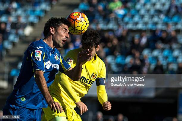 Juan Antonio Rodrguez of Getafe CF wins the header after Denis Suarez of Villarreal CF during the La Liga match between Getafe CF and Villareal CF at...
