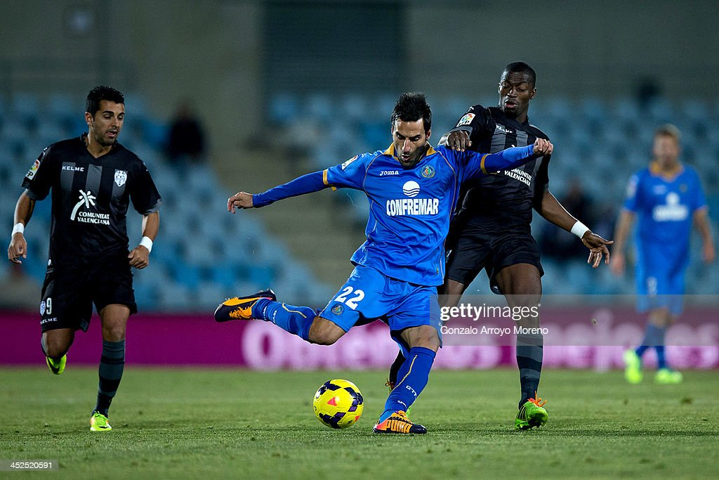 Juan Antonio Rodriguez (L) of Getafe CF competes for the ball with Papa Diop (R) of Levante UD during the La Liga match between Getafe CF and Levante UD at Coliseum Alfonso Perez on November 29, 2013 in Getafe, Spain.