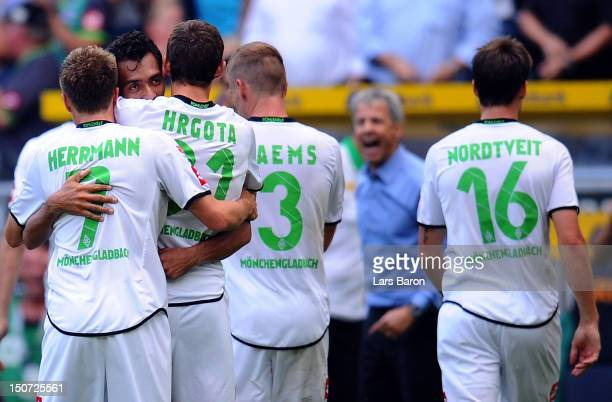 Juan Arango of Moenchengladbach celebrates with team mates and head coach Lucien Favre after scoring his teams second goal during the Bundesliga...