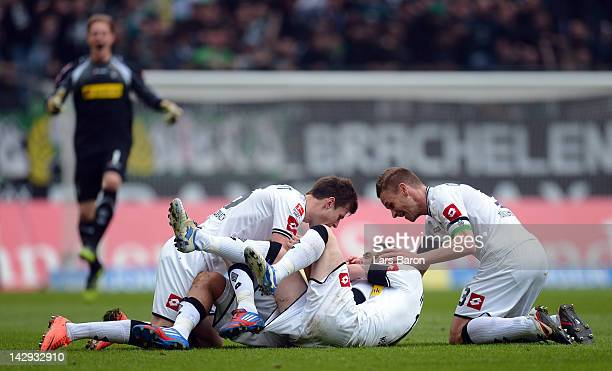 Juan Arango of Moenchengladbach celebrates with team mates Havard Nordtveit and Marco Reus after scoring his teams first goal during the Bundesliga...