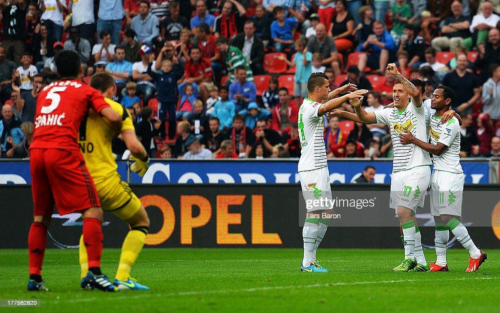 Juan Arango of Moenchengladbach celebrates with team mates Max Kruse Granit Xhaka and Raffael after scoring his teams third goal during the...