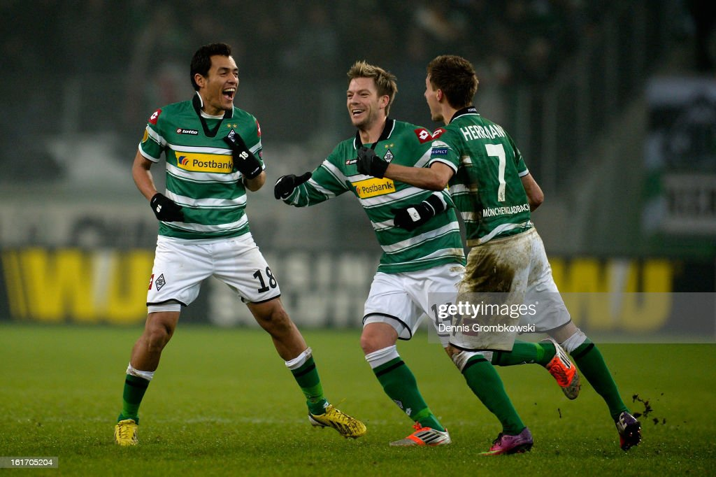 Juan Arango of Moenchengladbach celebrates with teammates after scoring his team's third goal during the UEFA Europa League round of 32 first leg match between VfL Borussia Moenchengladbach and S.S. Lazio at Borussia Park Stadium on February 14, 2013 in Moenchengladbach, Germany.