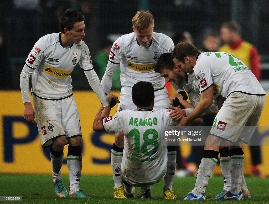 Juan Arango of Moenchengladbach celebrates with teammates after scoring the second goal during the Bundesliga match between VfL Borussia Moenchengladbach and 1. FSV Mainz 05 at Borussia Park Stadium on December 9, 2012 in Moenchengladbach, Germany.