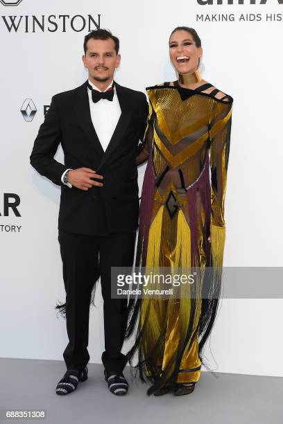 Juan Arbelaez and Laury Thilleman arrive at the amfAR Gala Cannes 2017 at Hotel du CapEdenRoc on May 25 2017 in Cap d'Antibes France