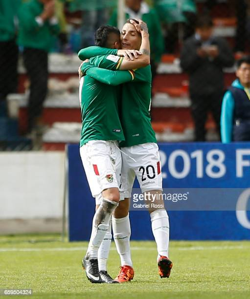 Juan Arce of Bolivia celebrates with Pablo Escobar after scoring the opening goal during a match between Bolivia and Argentina as part of FIFA 2018...