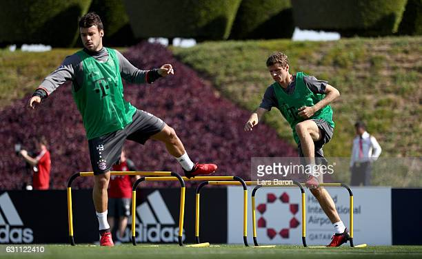 Juan Bernat and Thomas Mueller warm up during a training session at day 5 of the Bayern Muenchen training camp at Aspire Academy on January 7 2017 in...