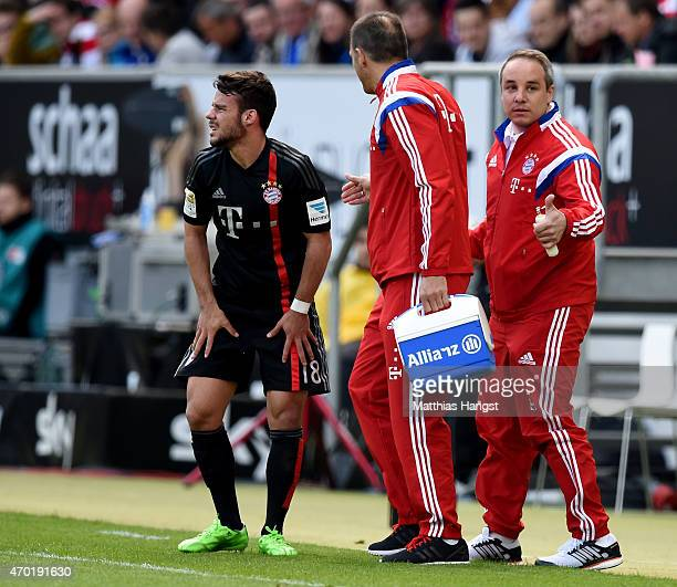 Juan Bernat gets medical treatment by Doctor Volker Braun new club doctor of Muenchen during the Bundesliga match between 1899 Hoffenheim and FC...