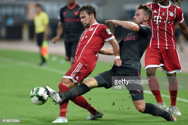 Juan Bernat of Bayern Muenchen and Aaron Ramsey of Arsenal compete for the ball during 2017 International Champions Cup China between FC Bayern...