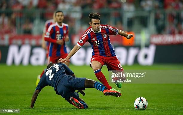 Juan Bernat of Bayern Muenchen is tackled by Ricardo Pereira of Porto during the UEFA Champions League Quarter Final Second Leg match between FC...